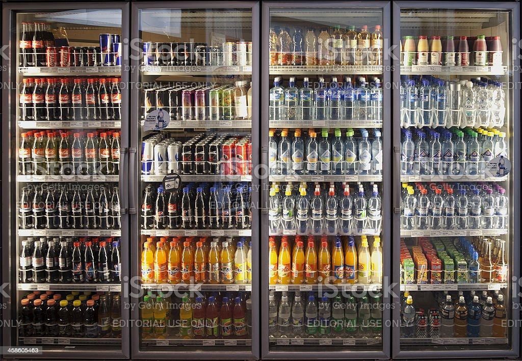 Glass cabinets with diverse range of softdrinks. stock photo