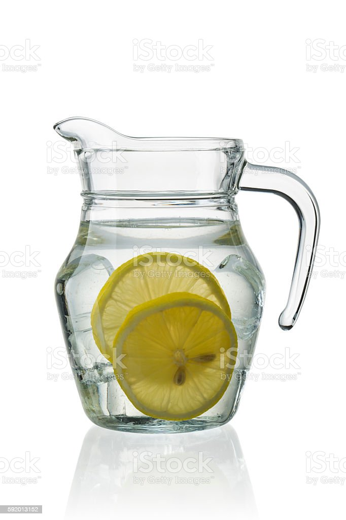 Glass carafe with lemon stock photo