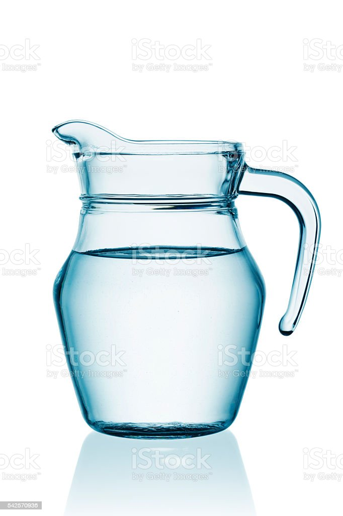 Glass carafe with water stock photo
