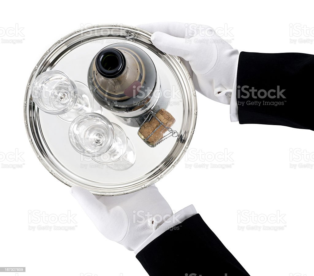 Glass champagne tray being held with gloved hands stock photo