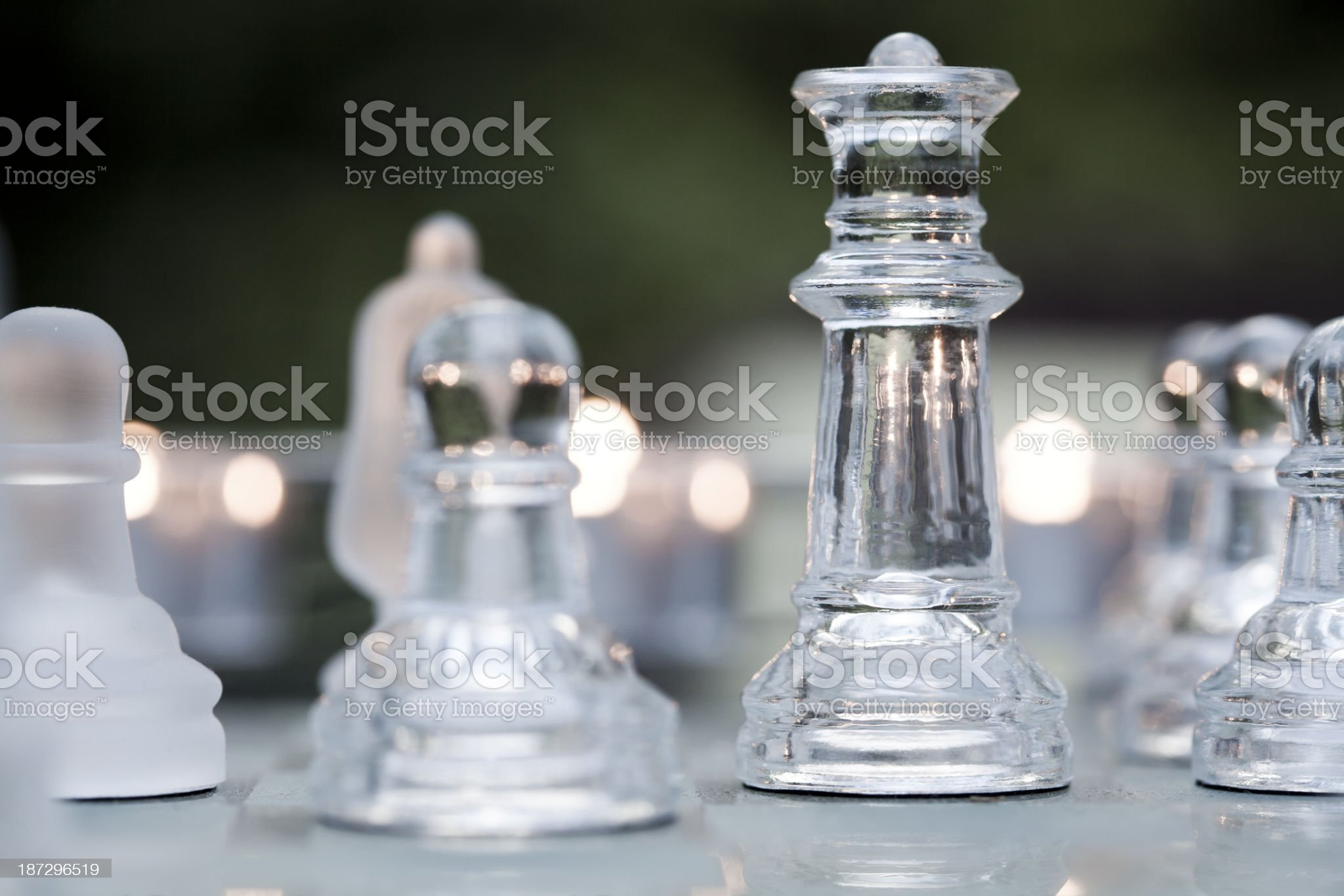 Glass chess and candle lights royalty-free stock photo