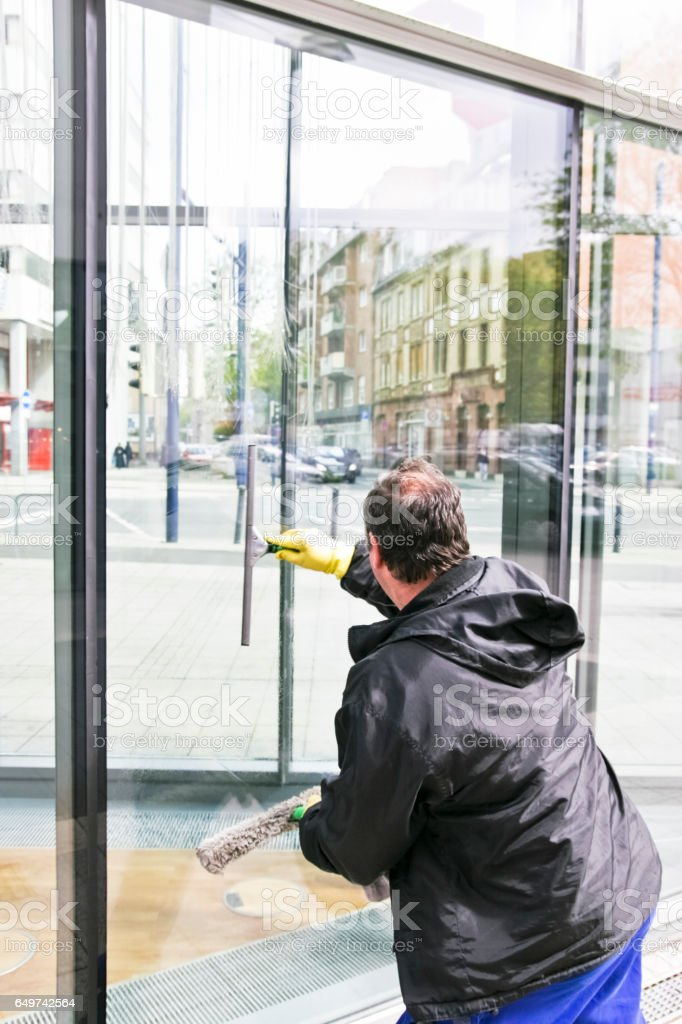 Glass Cleaner Cleaning a Glass Facade stock photo