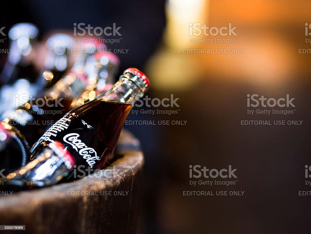 Glass Coca Cola bottles in wooden barrel, Borough Market, London stock photo