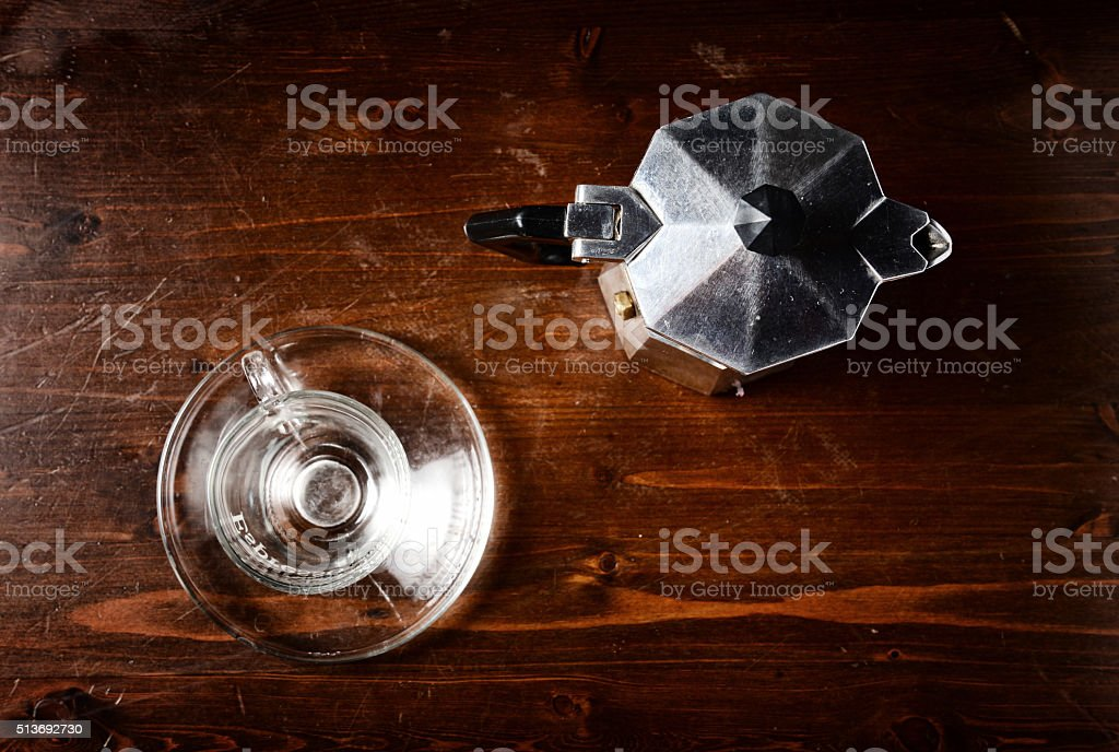 glass  coffee cup and  vintage coffeepot on dark wooden table stock photo
