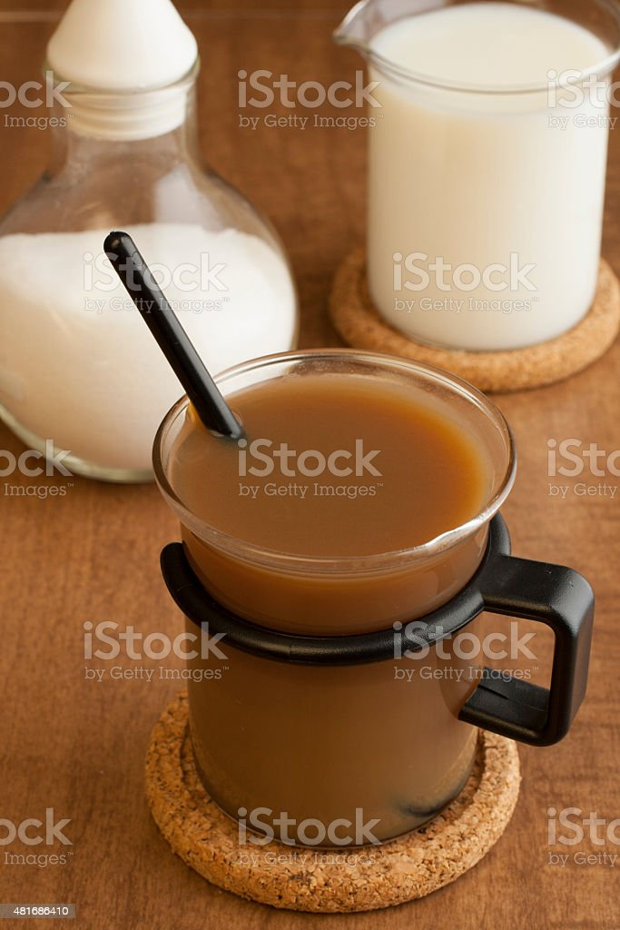 glass coffee cup with milk and sugar stock photo