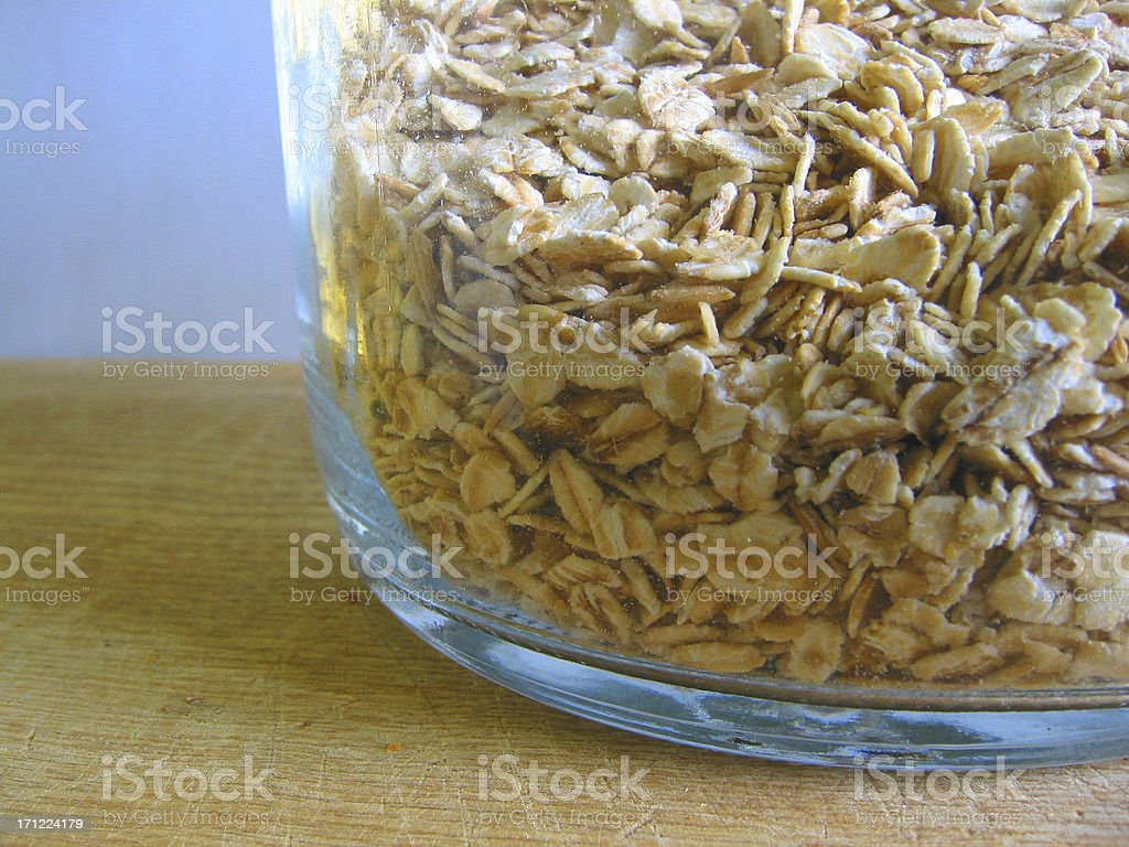 Glass container of oats royalty-free stock photo