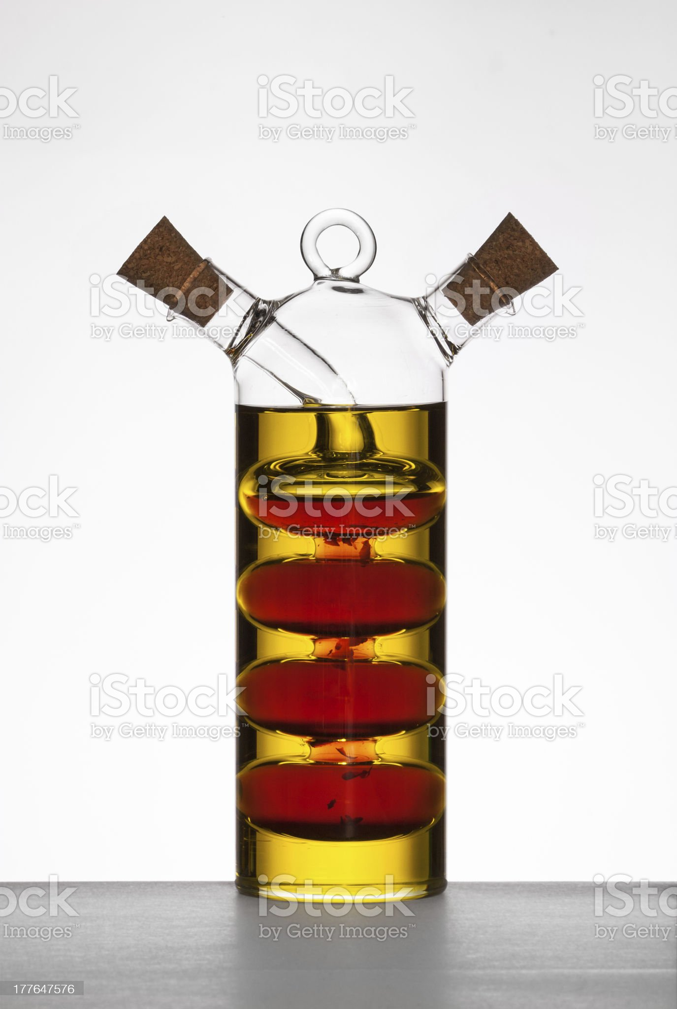 Glass cruet with olive oil and balsamic vinegar. royalty-free stock photo