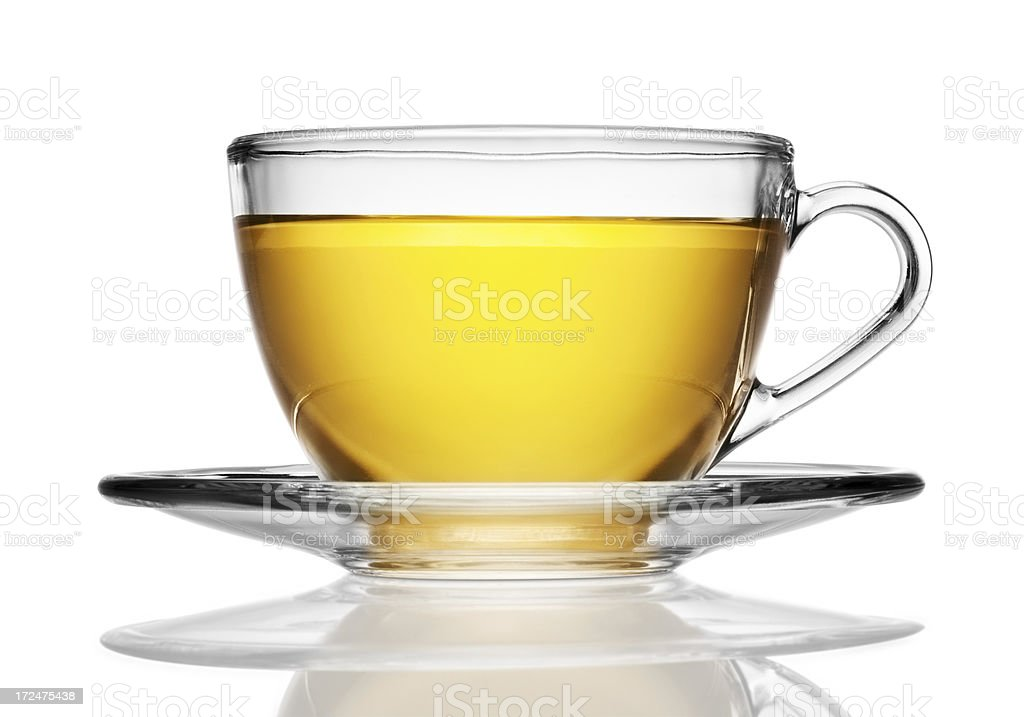 Glass cup and saucer of herbal tea isolated on white stock photo