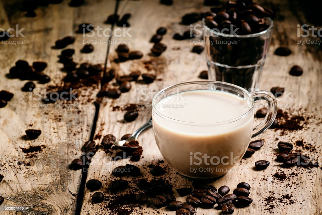 Glass cup of coffee with milk stock photo