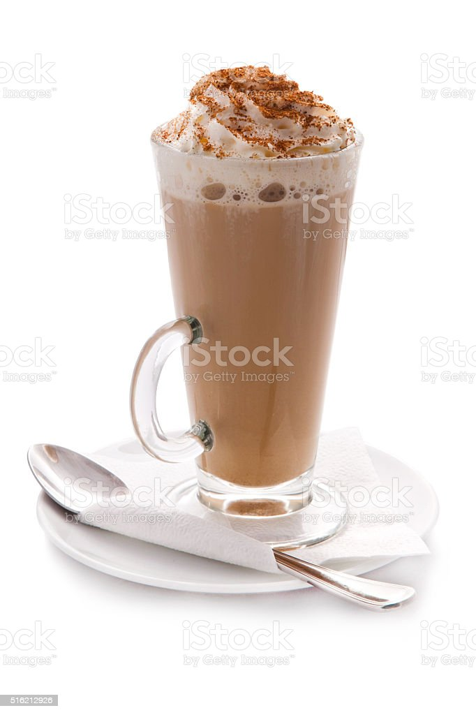 Glass cup of hot coffee with cream and cinnamon stock photo
