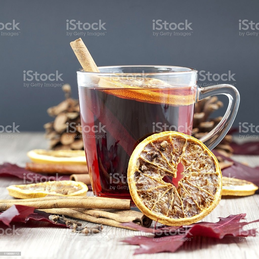 Glass cup of mulled wine with other ingredients royalty-free stock photo