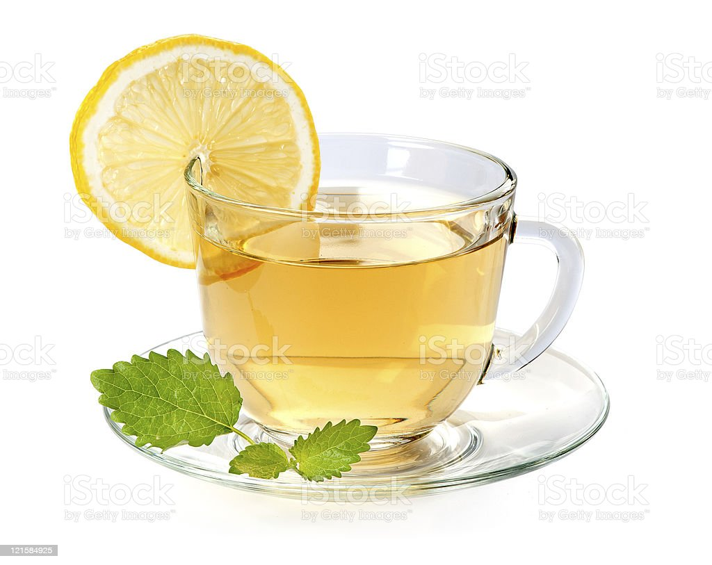 Glass cup of tea with lemon and leaf mint royalty-free stock photo