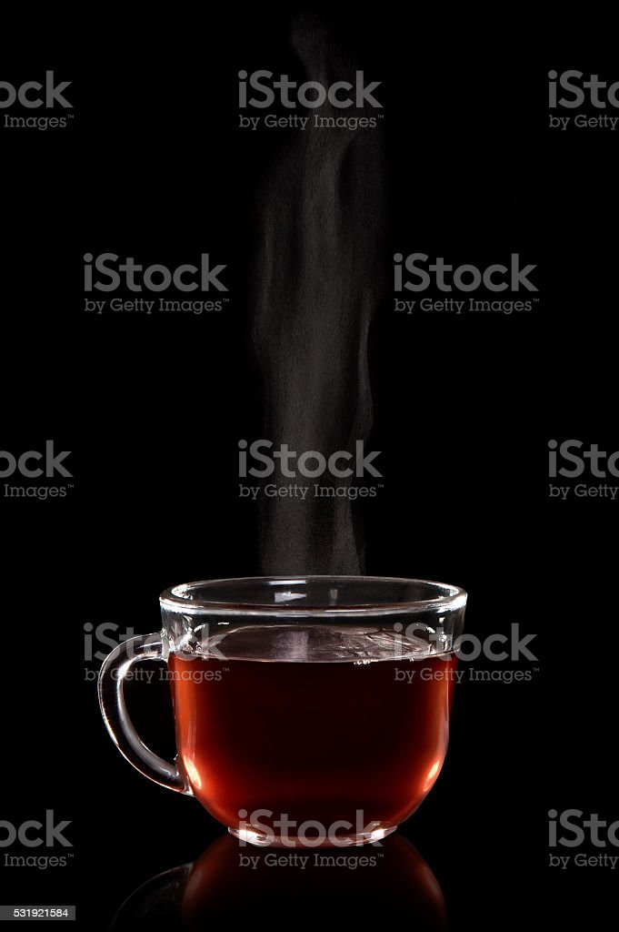 Glass cup of tea with vapor stock photo