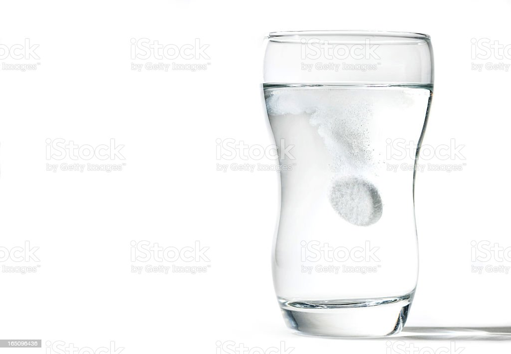 glass cup with effervescent tablet stock photo