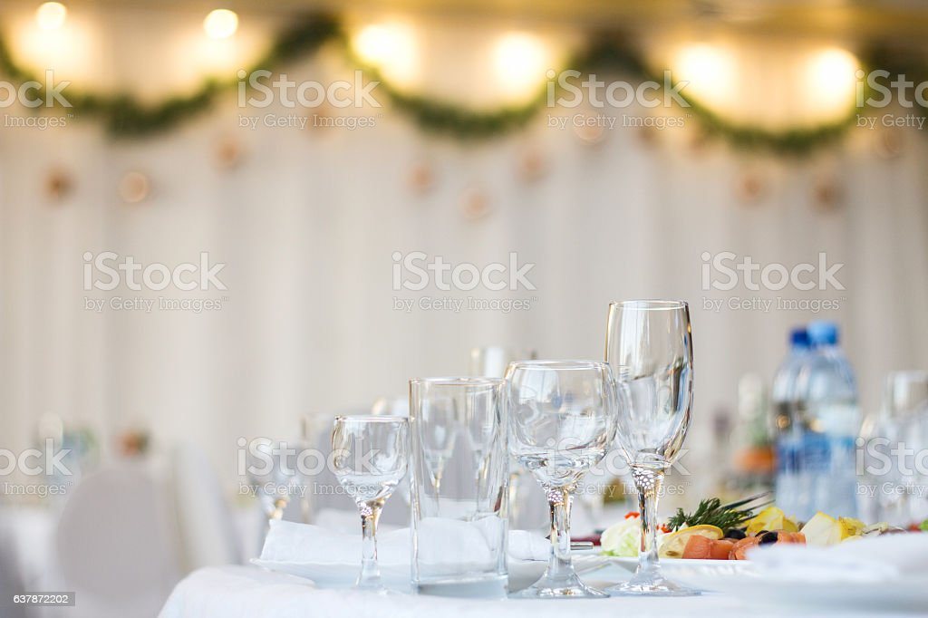 Glass cups and glasses on the table in a restaurant. stock photo