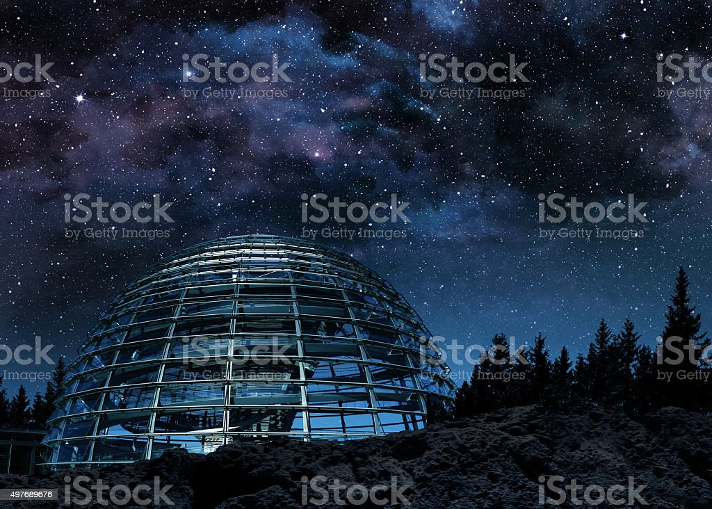 glass dome under the milky way stock photo