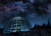 glass dome under the milky way