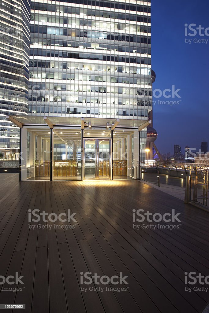 glass door and wooden Platform before lujiazui office building royalty-free stock photo