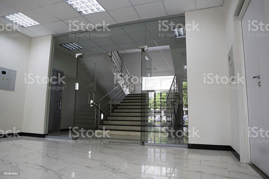 Glass door on stair entrance going up royalty-free stock photo