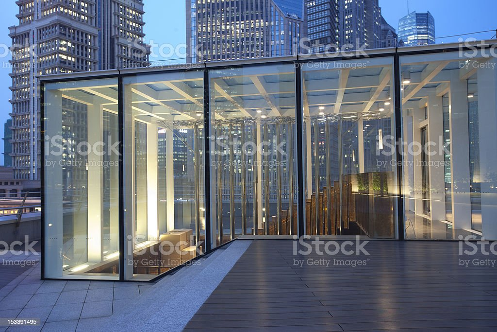 Glass door & wooden Platform before Lujiazui office building stock photo