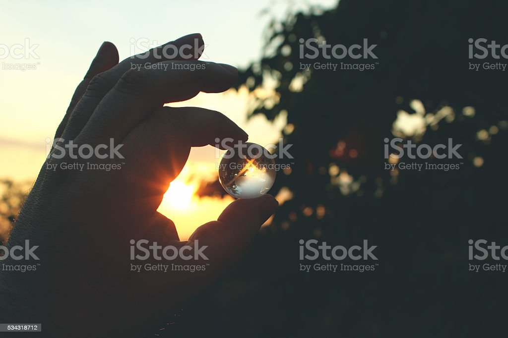 Glass earth in hand stock photo
