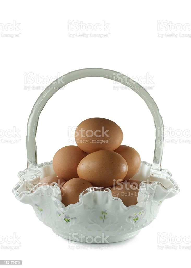 Glass Easter basket with eggs. royalty-free stock photo