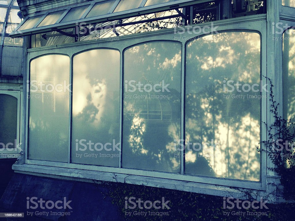 Glass exterior of building reflecting outward. stock photo