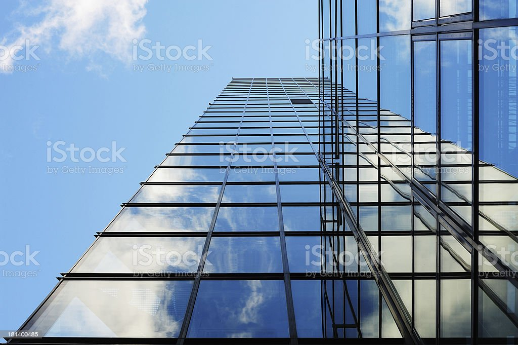 Glass facade building seen from below, copy space royalty-free stock photo