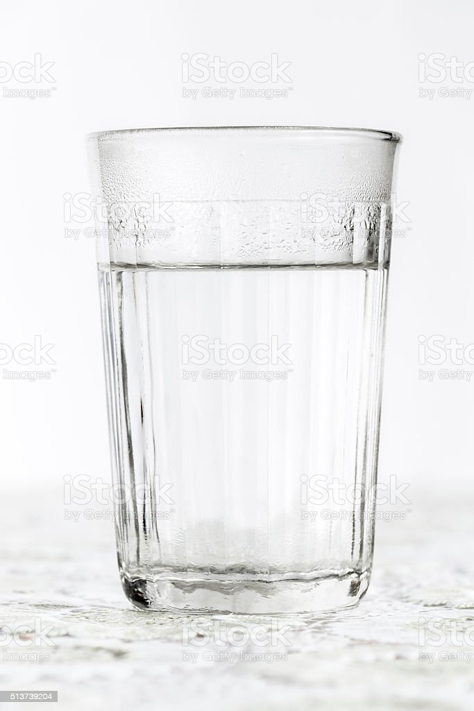 Glass faceted glass with boiling water stock photo