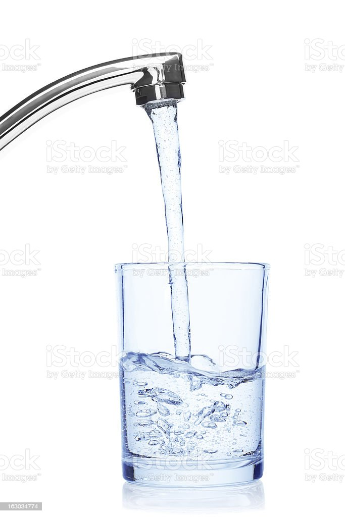 Glass filled with drinking water from tap. stock photo
