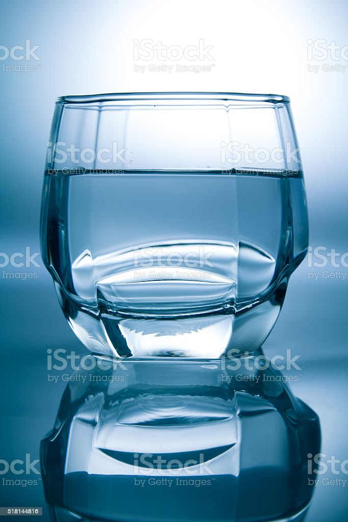 Glass filled with water stock photo