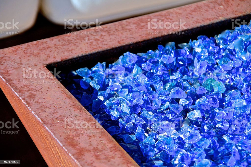 Glass Fireplace with Blue Rock stock photo