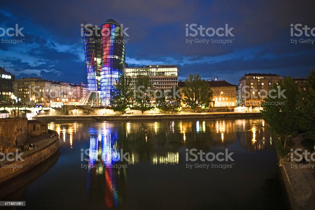 glass front of office tower by night royalty-free stock photo