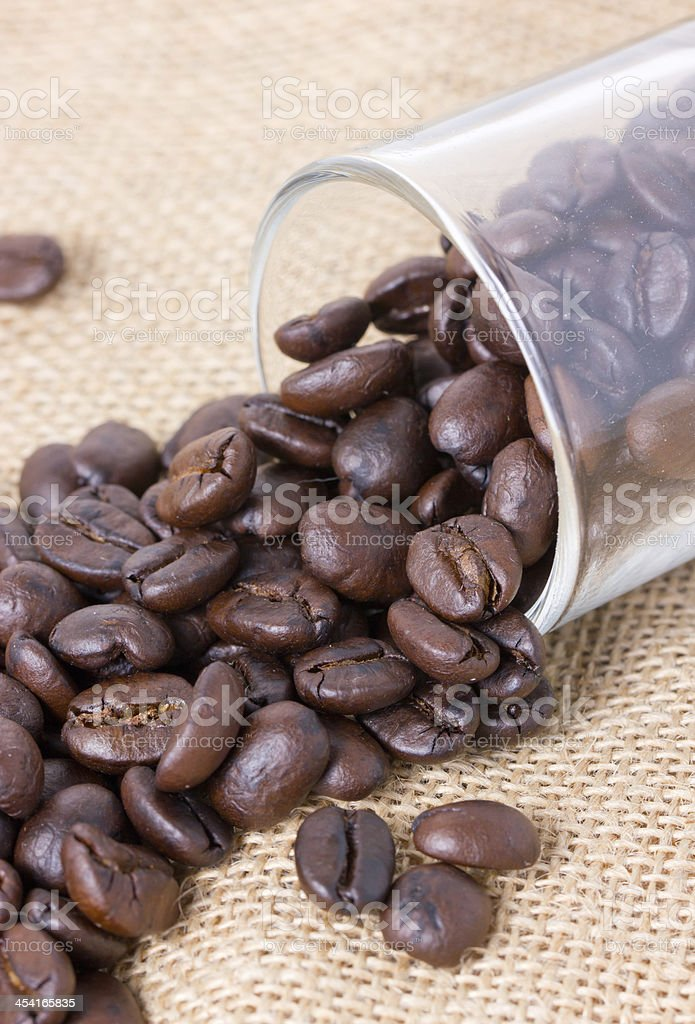 Glass full of coffee beans with sackcloth. royalty-free stock photo