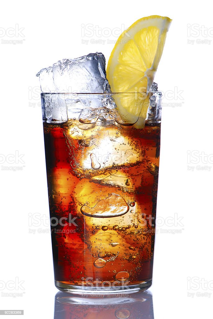 Glass full of cola with ice and lemon stock photo
