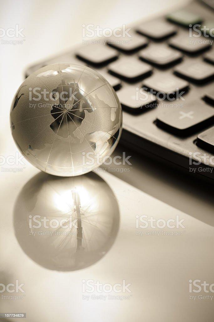 Glass globe and caculator stock photo