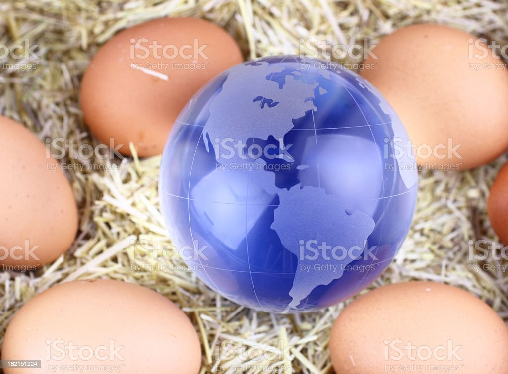 Glass globe and eggs royalty-free stock photo