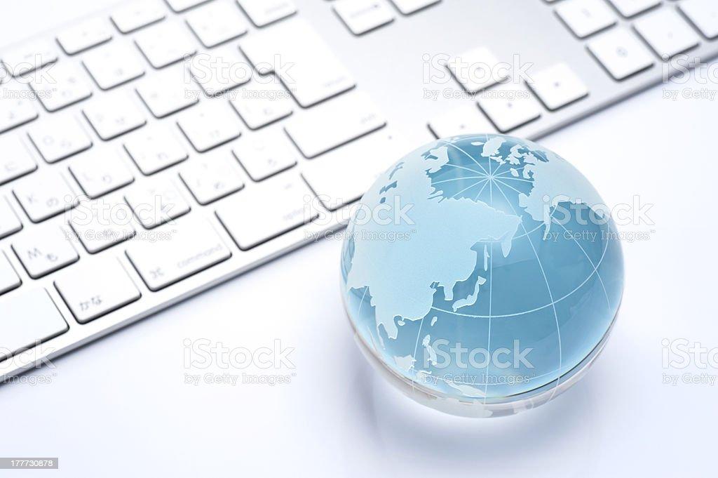 glass globe and keyboard stock photo