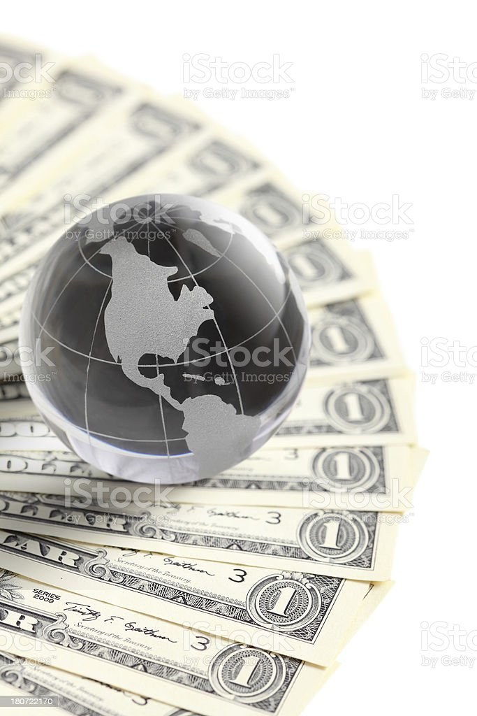 glass globe and money royalty-free stock photo