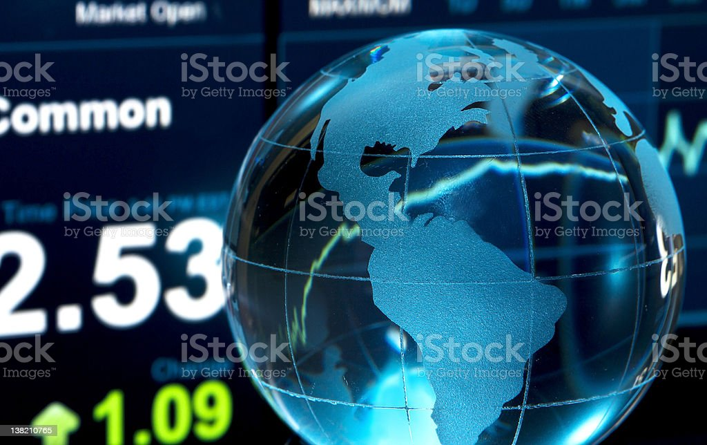 Glass globe in front of stock data stock photo