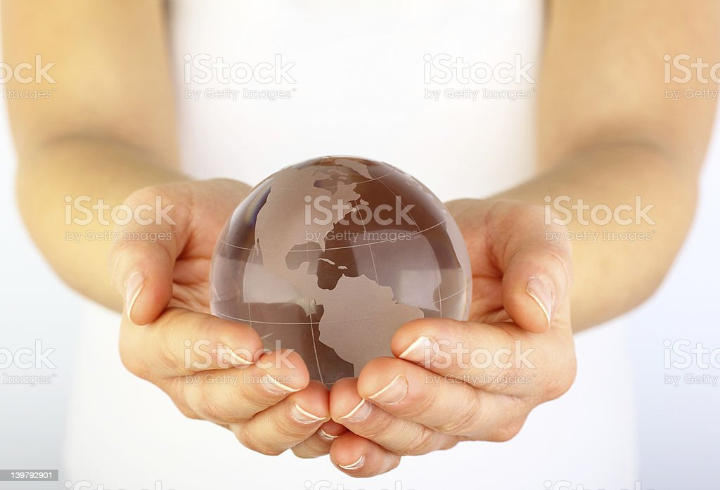 Glass globe in hands royalty-free stock photo