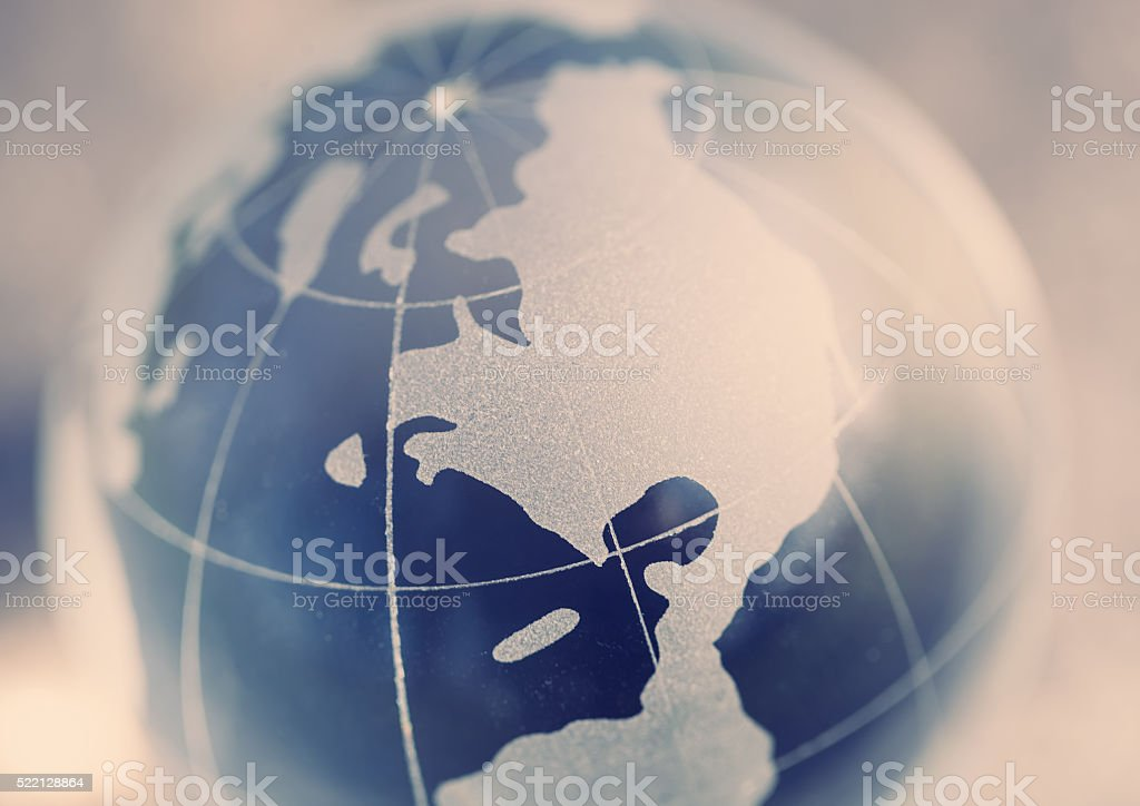 Glass globe model in macro stock photo