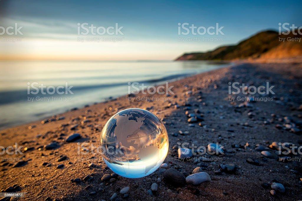 Glass Globe on Beautiful Lake Shore stock photo