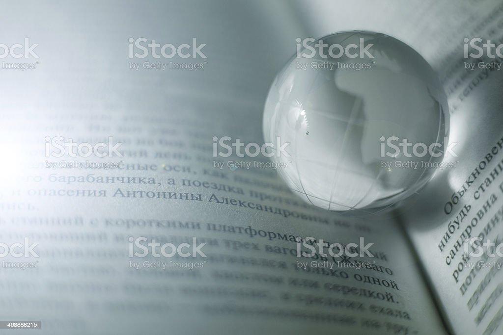 Glass globe on pages book royalty-free stock photo
