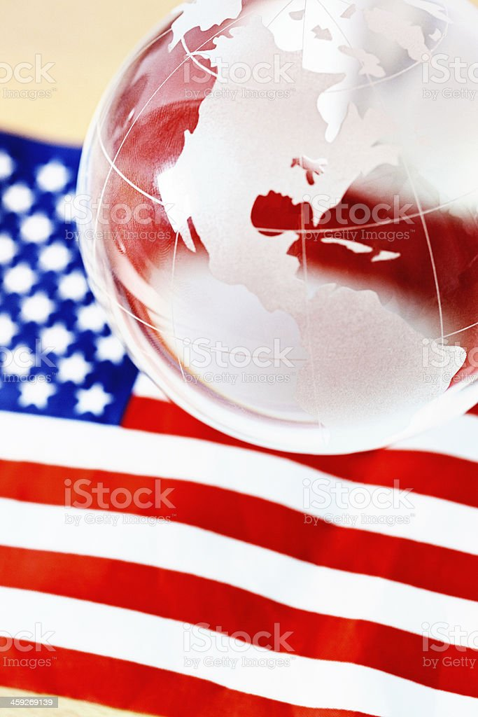 Crystal globe showing the Americas against the United States national...