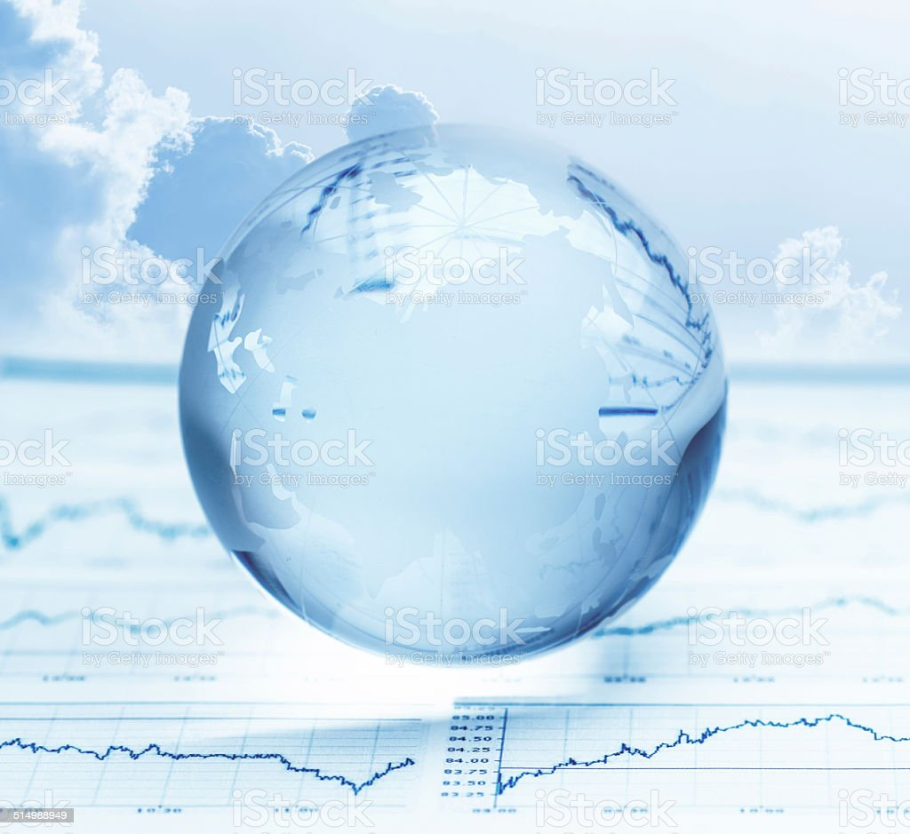 Glass globe on stock market chart dokument stock photo