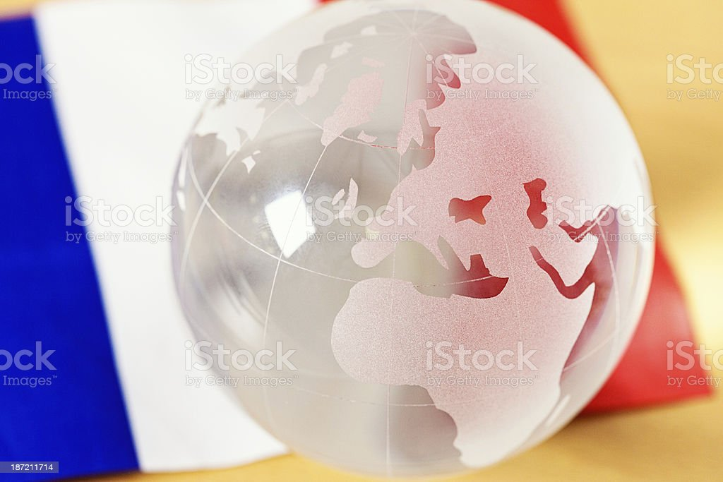 Glass globe showing Europe against French flag stock photo