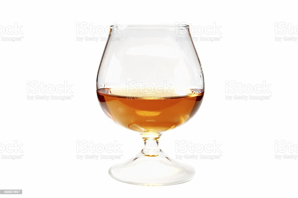 A glass half filled with Brandy stock photo