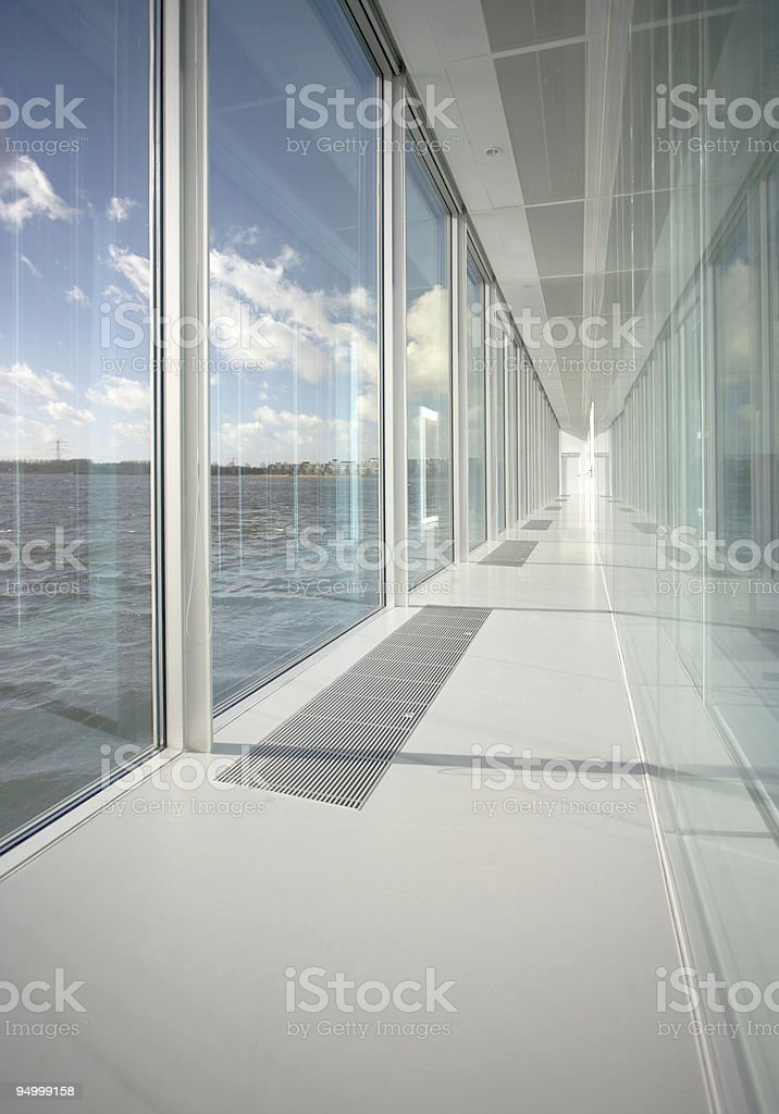 Glass hallway facing a lake royalty-free stock photo