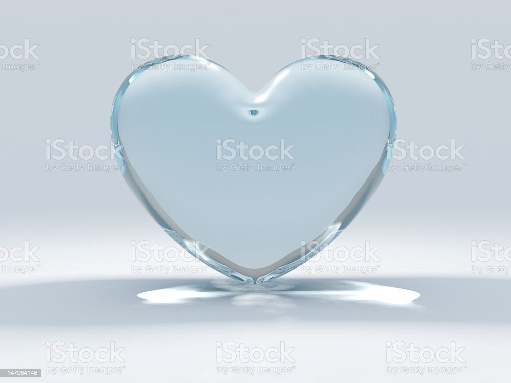 Glass heart set on a blue and white background stock photo